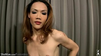 skinny redhead ladyboy with low hanging balls tugs.