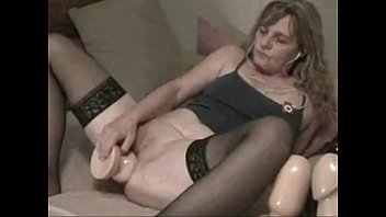 old lady uses big toys in the ass.