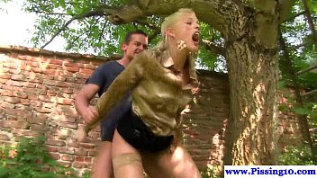 pissing slut gets clit licked outdoors