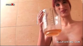 redhead bitch drinking her piss from a big cup