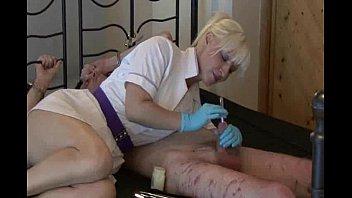 mistress nurse uses  sounds on her bound slave.