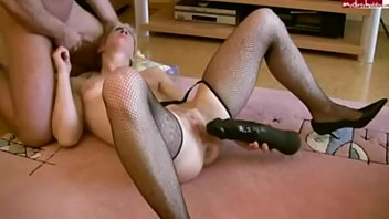 wife cums with a dildo in the ass.