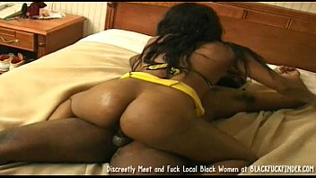 black woman in yellow lingerie takes 2 cocks.