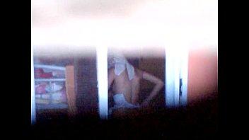 voyeur woman changing clothes