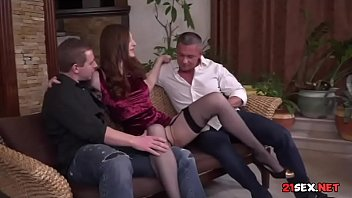 stockings and garter belt babe sucking off two men