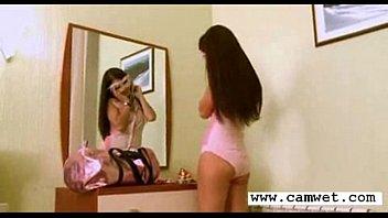brunette girl stripping in bedroom