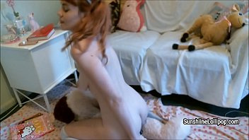 redhaired cutie sunshine lollipop plays with plush toy.