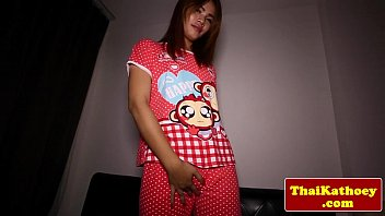 young thai ladyboy inserts toy in.