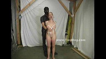 masked man in dark suit ties.