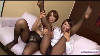 asian girl in pantyhose rubbing other girl tits.
