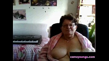 naughty granny flashing her big tits on cam:.