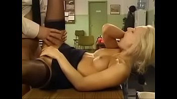 blonde police woman has sex on desk in.