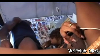chocolate woman stands doggystyle getting screwed.