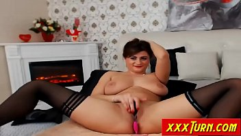 busty mature rubs her pussy shaved on webcam.
