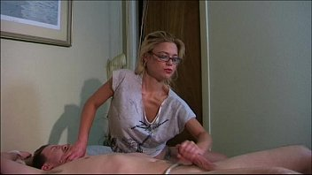 sexy lady ties a man on the bed.