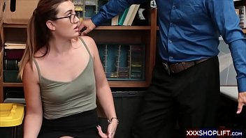 geeky shoplifter chick with glasses caught.