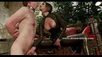 woman shocks a tied up man bound in.