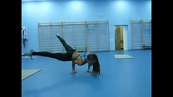 sexy strong and flexible girl in a gym.