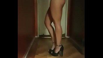sexy brunette dances lifting the dress.