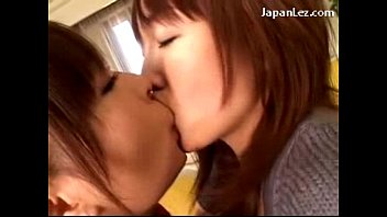 asian girl kissing passionately getting her tits rubbed.