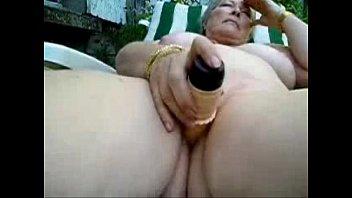 pervert nude granny masturbates outdoor. amateur.
