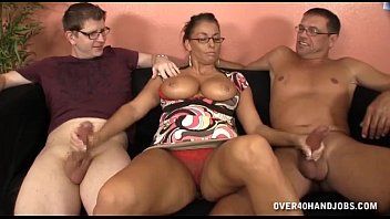 busty lady jerks off two cocks