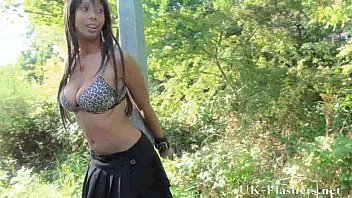 ebony teen babe flashes tits and pussy outdoors.