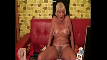 horny granny plays with milk. see more at 747cams.com