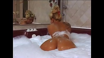 sexy class woman with big tits taking a bath