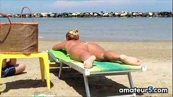 thick white woman tanning at the.