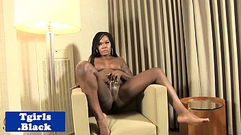 busty black tgirl plays with herself