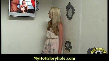 sucking strangers cocks through a gloryhole.