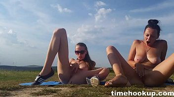 two young girls masturbate outdoors