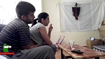 bored couple watching tv decide to have fun.